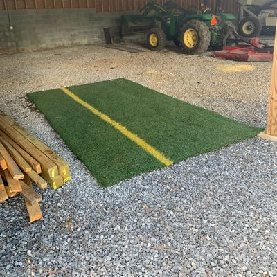 Turf for 18's teepad is inside shed behind the tee