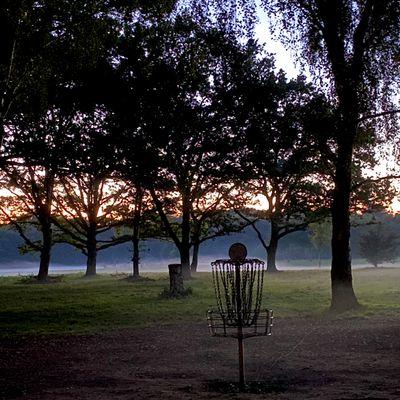 Hole 8's basket at sundown
