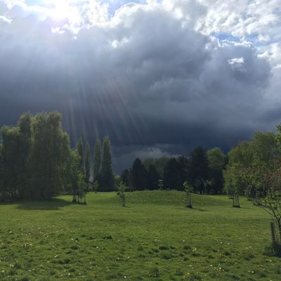 Liquid sunshine and an ominous sky. View from the 6th fairway towards the 3rd basket on the mound.