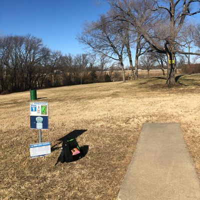Hole 1. With the trees, distance, building and OB, hard to imagine that the pros birdie this one.