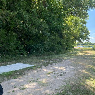 Hole 7, short teepad. Big blind hyzer shot. Watch for pedestrians walking along the path.