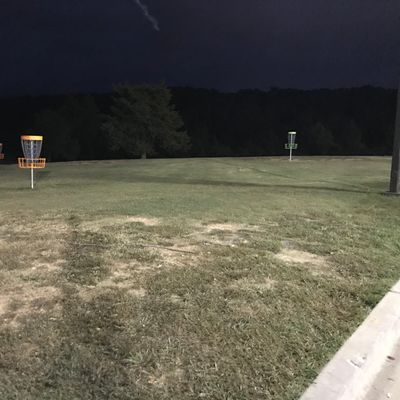 Practice basket area at night. Great spot to putt.